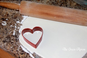cut out heart shapes from the white fondant